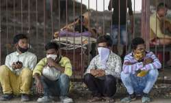 Stranded migrant workers take shelter under a flyover in Mumbai.- India TV Paisa