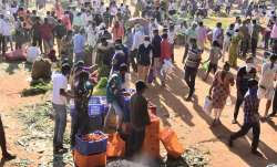 People buy vegetables during nationwide lockdown imposed in the wake of coronavirus pandemic.- India TV Paisa