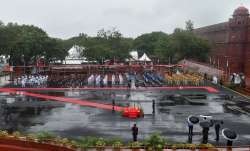 Tri-Service bands and Delhi Police contingent march-past during full dress rehearsals for the 74th I- India TV Paisa