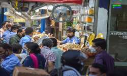 New Delhi: People buy dry fruits from a...- India TV Paisa