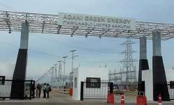 TOTAL acquires 20 pc stake in Adani Green Energy- India TV Paisa