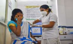 India Corona Vaccination news health ministry says 165714 people were vaccinated on first day- India TV Paisa
