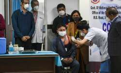 Coronavirus Vaccination:  Healthcare workers consulting colleagues, scouring Internet before taking - India TV Paisa