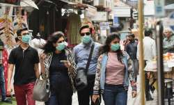 Wearing two fitted masks may double protection against COVID-19: Study- India TV Paisa