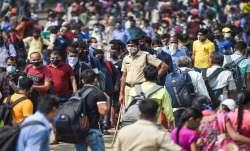 Migrant workers Mumbai Lokmanya Tilak Terminus Railway station to board trains to UP Bihar Jharkhand- India TV Paisa
