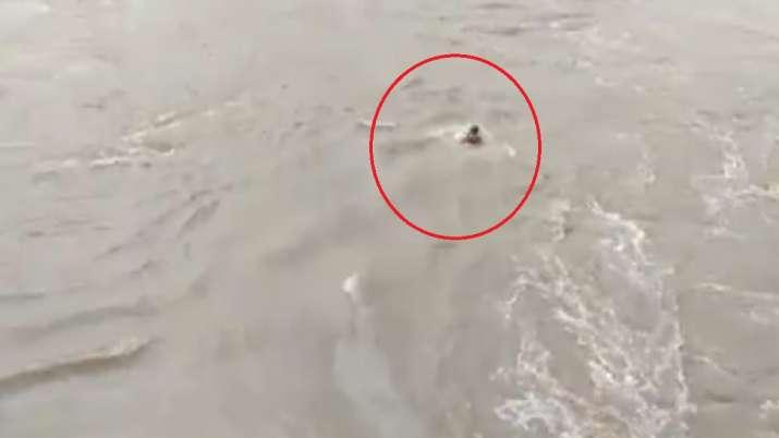 Pujari jumped in flooded river in karnataka