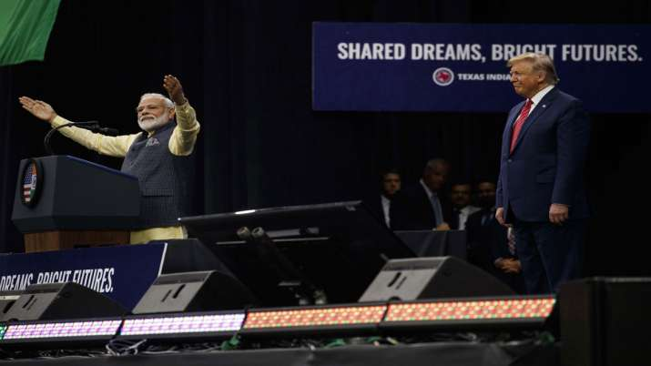 President Donald Trump stands on stage with Indian Prime Minister Narendra Modi