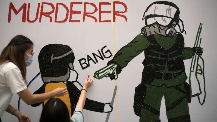 Hong Kong police slammed in fresh protests over shooting of teenage boy | AP
