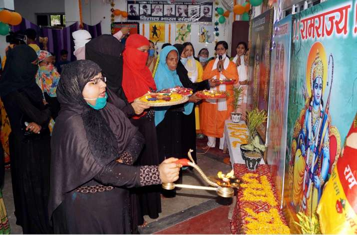 Members of the Muslim community perform 'aarti' of Lord Ram as they celebrate the ground breaking ce