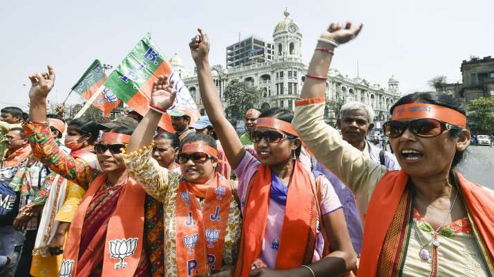BJP supporters during a rally to attend Prime Minister Narendra Modi's election meeting ahead of Wes