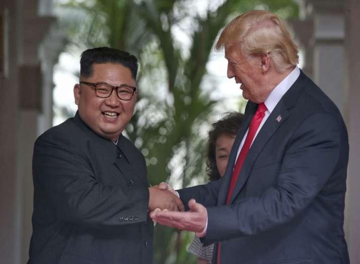 U. S. President Donald Trump shakes hands with North...- India TV Hindi