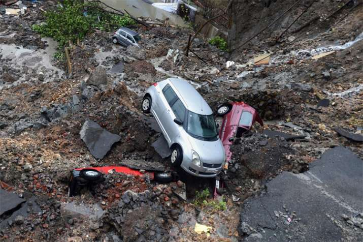 Mumbai Rains: Cars buried as wall collapses after heavy rain, trains services disrupted   PTI- India TV