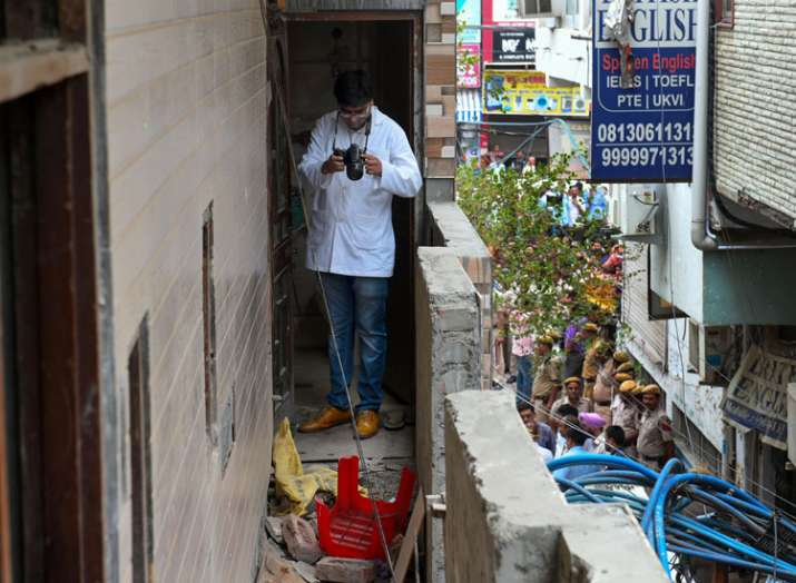 A forensic expert inspects the house, where 11 members...- India TV