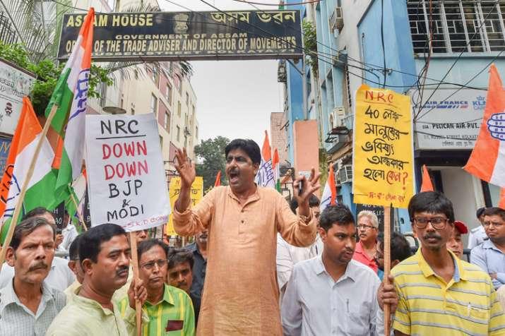 Congress activists raise slogans during a protest...- India TV