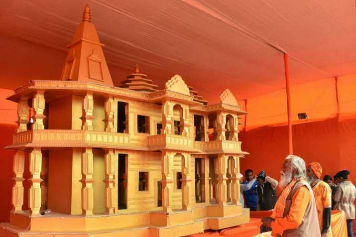 People look at a model of Ram Mandir, to be built in...- India TV Hindi