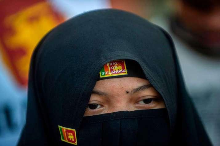 Sri Lanka bans burqas for 'public protection' after bomb attacks- India TV