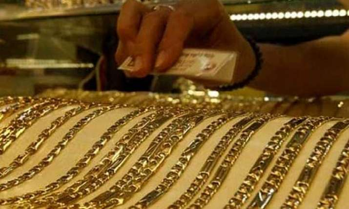 Gold prices fall on muted demand from jewellers; silver firms up- India TV Paisa