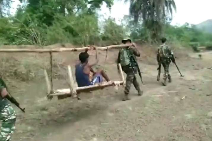 CRPF found a severely ill boy in a Chhattisgarh village and carried him on a cot for 8 km for treatm- India TV Hindi