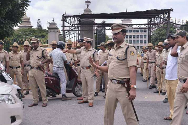 Police personnel stand guard at the entrance of the...- India TV