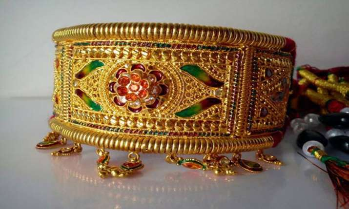 Gold slides by Rs 130 on muted demand, weak global cues- India TV Paisa
