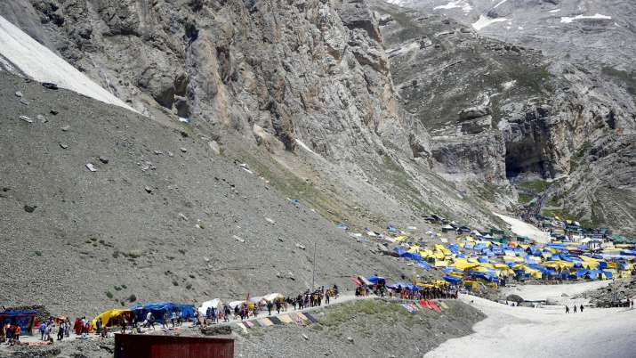 Hindu devotees on their way to the holy cave shrine of...- India TV