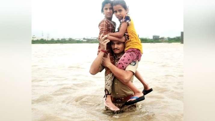 Constable Prithiviraj Singh Jadeja rescuing two girls from gujarat flood - India TV