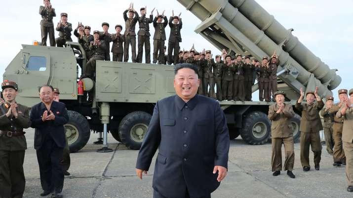 North Korean leader Kim Jong Un oversaw test of 'super-large multiple rocket launcher'   AP File- India TV