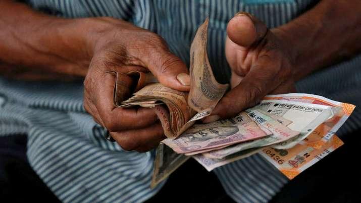 Rupee tanks 95 paise, falls below 76 level against US dollar amid coronavirus scare- India TV Paisa