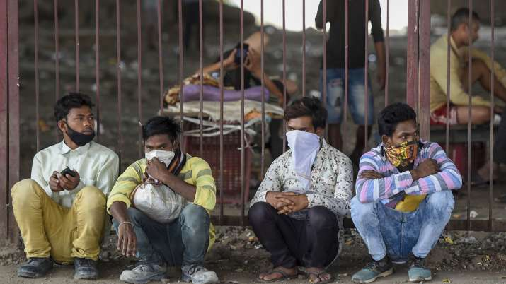 Stranded migrant workers take shelter under a flyover in Mumbai.- India TV Hindi