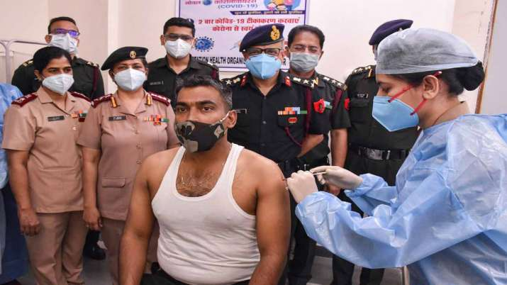 Indian Army personnel receives a dose of COVID-19 vaccine at a military hospital in Jabalpur- India TV Paisa