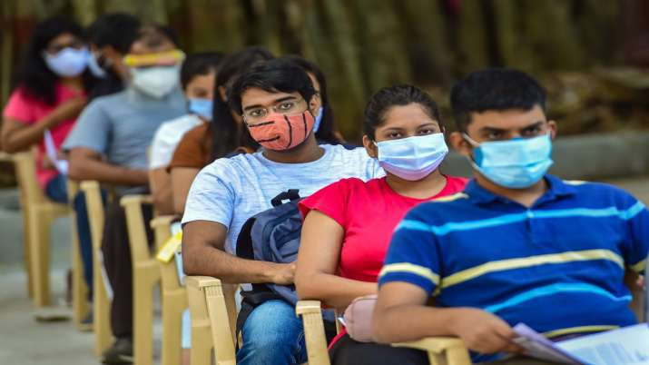 Students wait in a queue to receive COVID-19 vaccine doses during a special vaccination drive for th- India TV Paisa