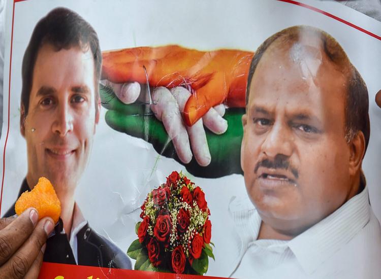 A poster of Congress President Rahul Gandhi and JD(S)...- India TV Hindi
