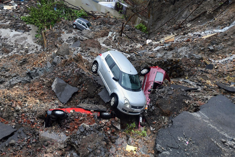 Mumbai Rains: Cars buried as wall collapses after heavy rain, trains services disrupted | PTI- India TV Hindi