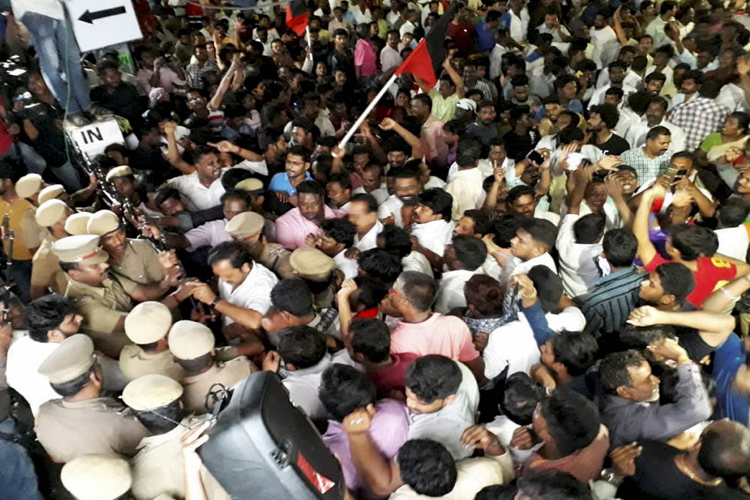 DMK supporters wait outside a private hospital, where...- India TV Hindi
