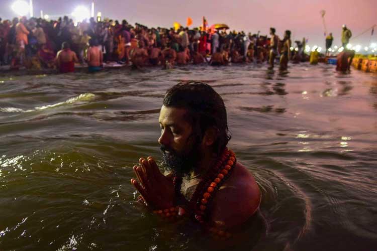 A Sadhu takes a holy dip at Sangam on the auspicious day...- India TV Hindi