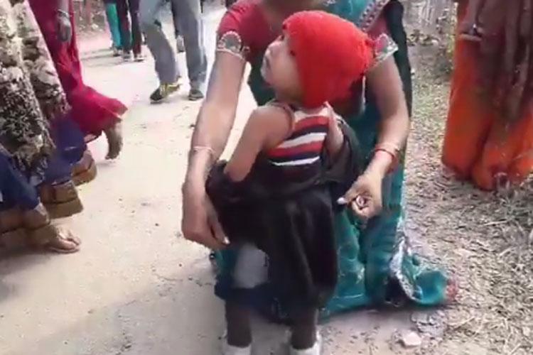 Crying toddler forced to remove black jacket before Sarbananda Sonowal rally- India TV Hindi