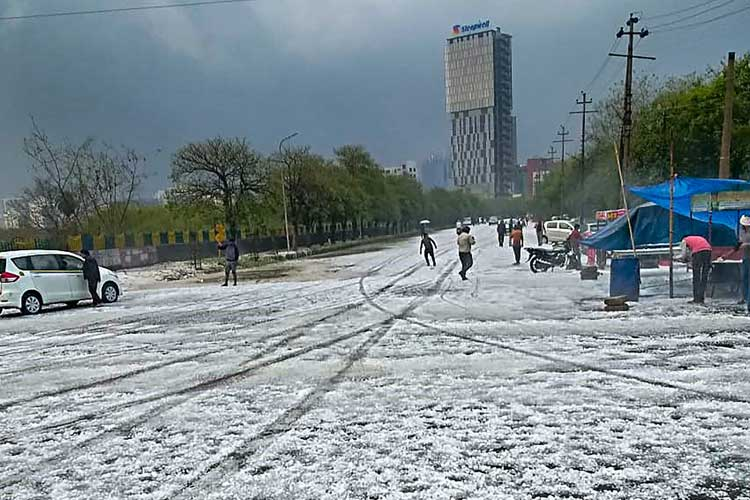 A view of a street after hailstorm struck various parts...- India TV Hindi