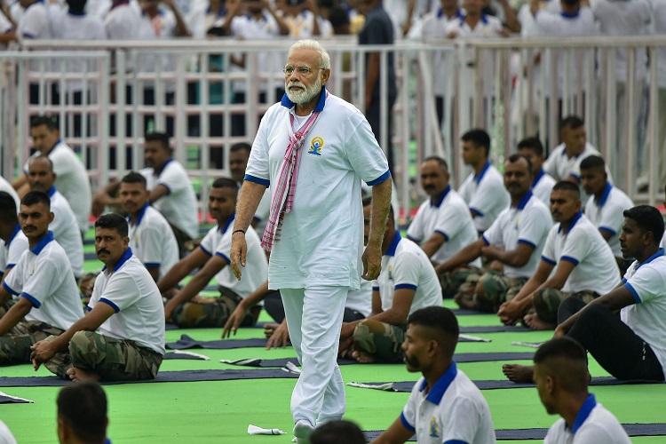 Prime Minister Narendra Modi during a mass yoga event...- India TV Hindi