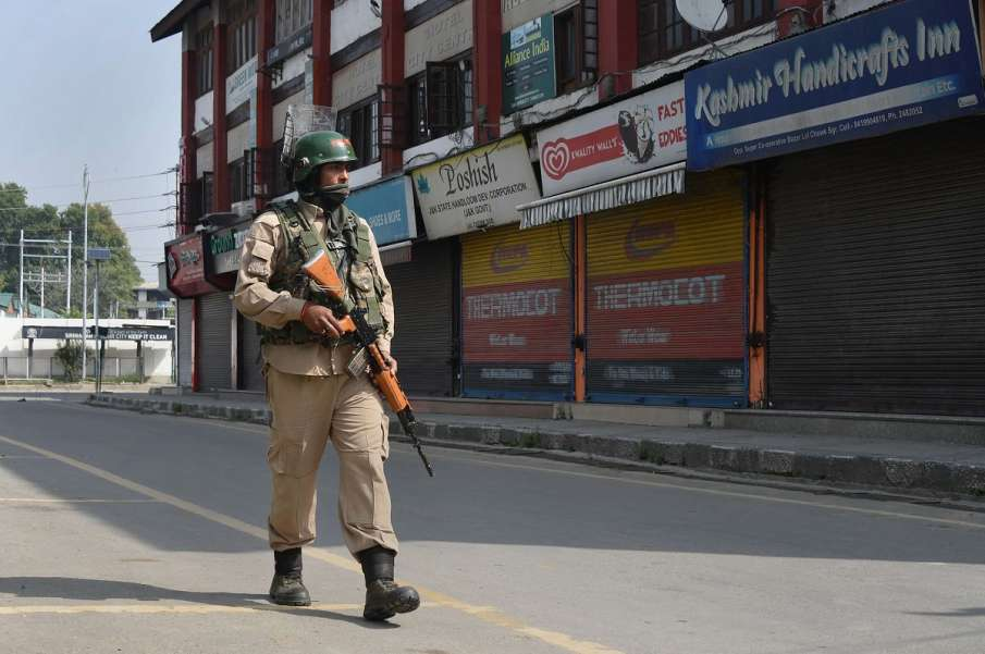 A security personnel patrols a street during...- India TV Hindi