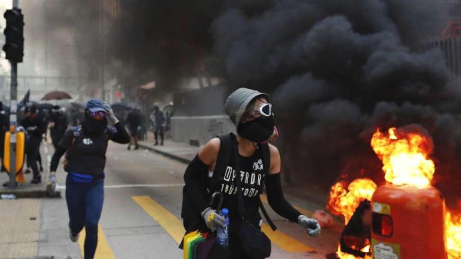 Hong Kong police slammed in fresh protests over shooting of teenage boy | AP- India TV Hindi