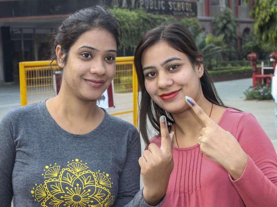 Voters show their inked fingers after casting their...- India TV Hindi
