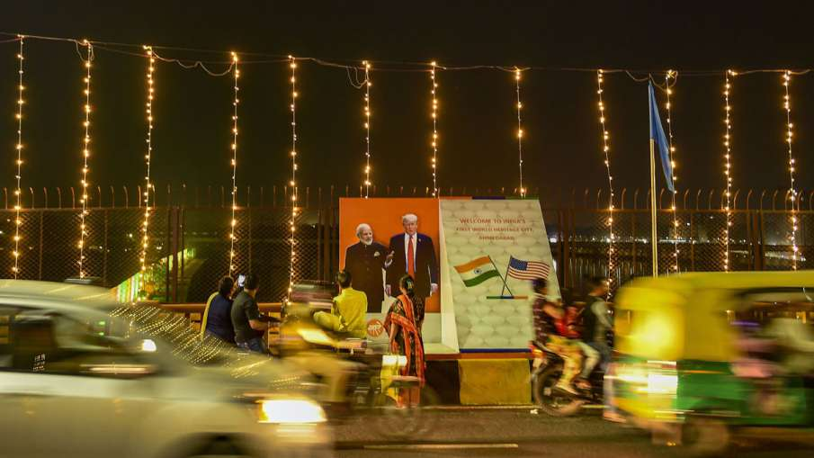 Vehicles drive past a hoarding of Prime Minister...- India TV Hindi