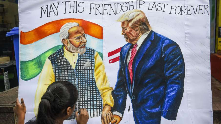 A child makes a painting depicting US President Donald...- India TV Hindi