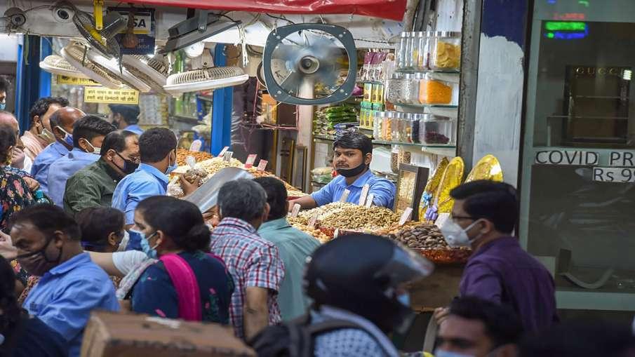 New Delhi: People buy dry fruits from a shop at Chandni...- India TV Hindi
