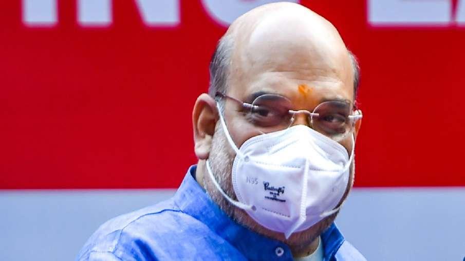 मास्क पहनना करना होगा अनिवार्य, पीएम मोदी के साथ बैठक में अमित शाह का बयान- India TV Hindi