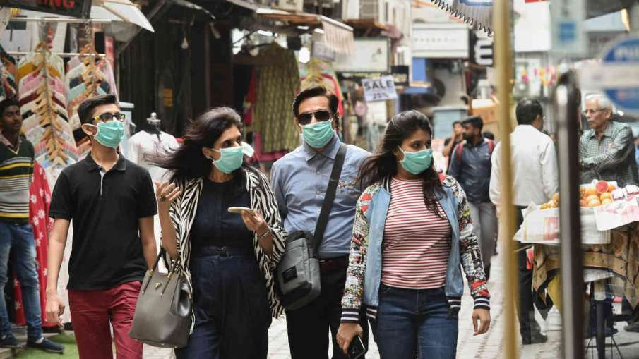 Wearing two fitted masks may double protection against COVID-19: Study- India TV Hindi
