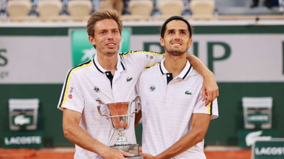 Nicolas Mahut and Pierre Hughes Herbert won the men's doubles title of the French Open tennis tourna- India TV Hindi