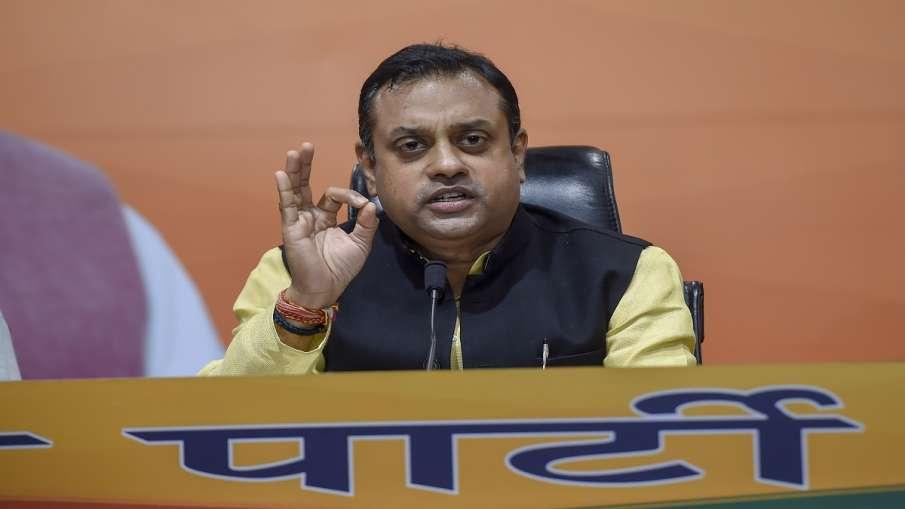 sambit patra bjp on kejriwal govt ghar ghar rashan yojana केजरीवाल सरकार की 'घर-घर राशन' योजना पर रो- India TV Hindi