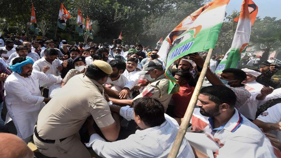 Police personnel stop Indian Youth Congress members who were staging a protest demanding the immedia- India TV Hindi